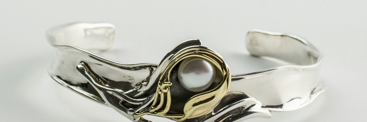 Sterling silver, gold, and pearl bangle