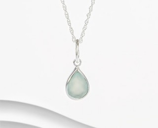 Sleek sterling silver with subtle chalcedony detail.