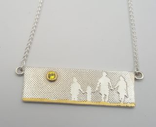 Beach family silver and gold necklace by Charlotte Lowe