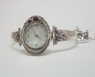 sterling silver garnet watch with oval face